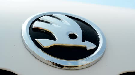 editorial : view of the glosyy symbol of skoda cars - detail