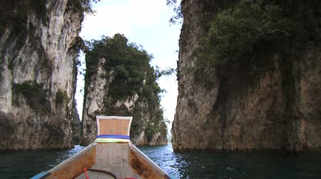 cliff : Boat sailing to Island on Blue Sea Stock Footage
