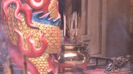 atrás : joss stick in Chinese Joss House.Smoke from Joss Stick blow every once in a while.