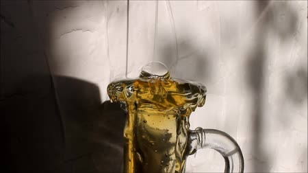 drizzler : honey poured into bottle Stock Footage