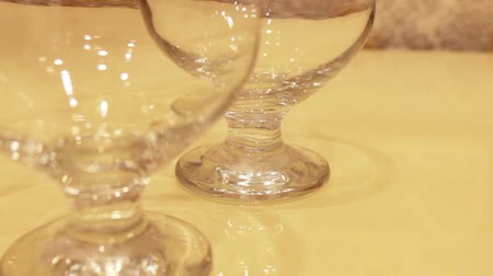 liquor : polished cognac glasses put the table one by one