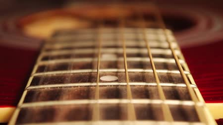 pin up : In the frame of the neck of an acoustic guitar, strings and frets Stock Footage