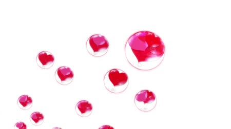 お気に入り : red hearts in the bubbles, fly up, on a white background