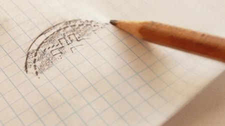 emelkedő : Bitcoin engraving on a notebook sheet with a pencil, hatching appears on the lines in the cells