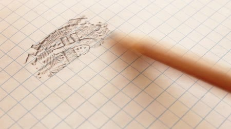 romsvetnik : Bitcoin engraving on a notebook sheet with a pencil, hatching appears on the lines in the cells