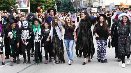careta : Gabrovo, Bulgaria May 19 2018.Traditional Carnival of Humor and Satire. Street art. Participants in the carnival procession. Stock Footage