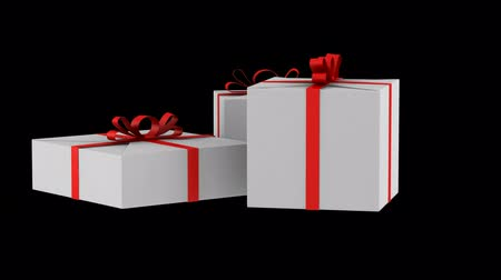 three white gift boxes with red ribbon and bow loop rotate on black background Stok Video