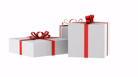 three white gift boxes with red ribbon and bow loop rotate on white background Stok Video