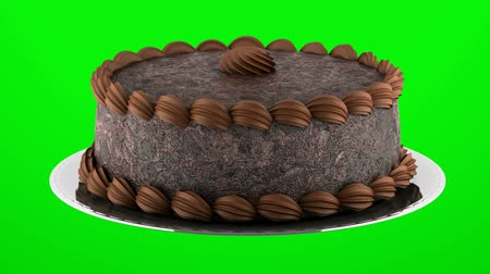 round chocolate cake loop rotate on green chromakey background