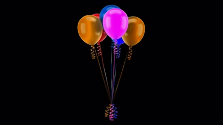 multicolored party balloons with ribbons loop rotate on black background