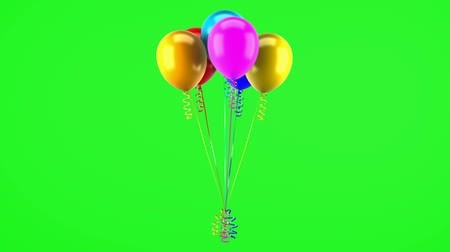 multicolored party balloons with ribbons loop rotate on green chromakey background Stok Video