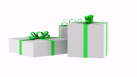 three white gift boxes with green ribbon and bow loop rotate on white background