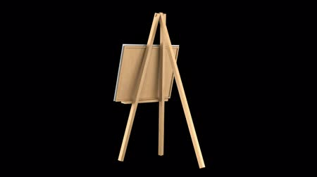 canvas : wooden easel with blank canvas loop rotate on black background