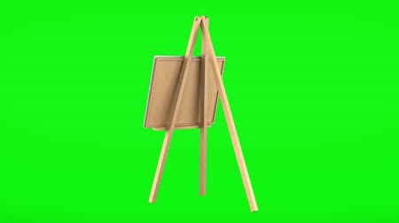 canvas : wooden easel with blank canvas loop rotate on green chromakey background