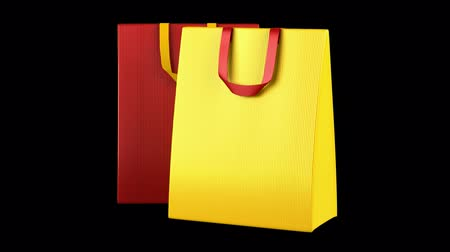 two red and yellow shopping bags loop rotate on black background