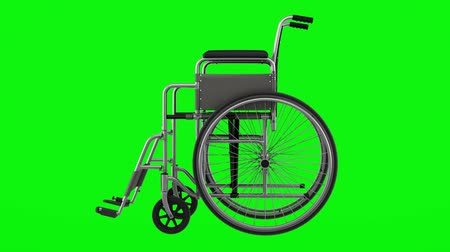 invalid chair loop rotate on green chromakey background Stok Video