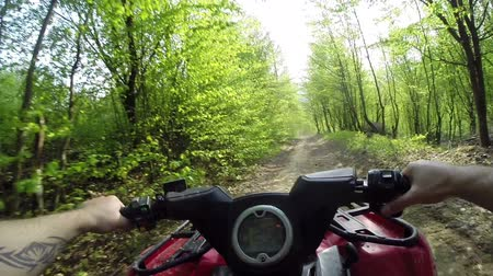 driving POV mountain off-road on ATV