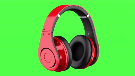 red and black wireless headphones loop rotate on green chromakey background Stok Video