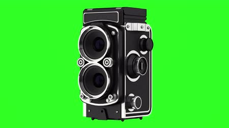 vintage film photo camera loop rotate on green chromakey background