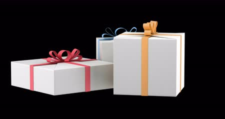 gift boxes with color ribbons and bows loop rotate on black background Stok Video