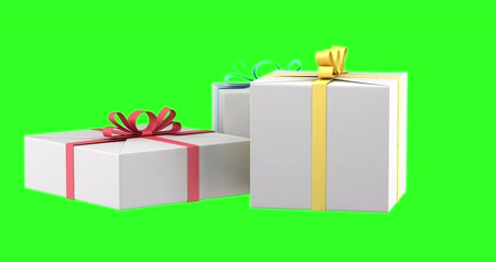 gift boxes with color ribbons and bows loop rotate on green chromakey background