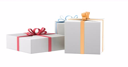 gift boxes with color ribbons and bows loop rotate on white background Stok Video