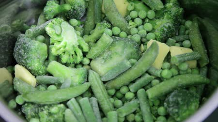 cooking pots : steaming frozen green vegetables like peas, broccoli and beans cooking in cooking jar