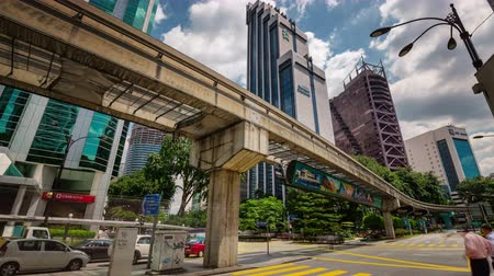 kuala lumpur skyline : day light under the bridge traffic 4k time lapse from luala lumpur city Stock Footage