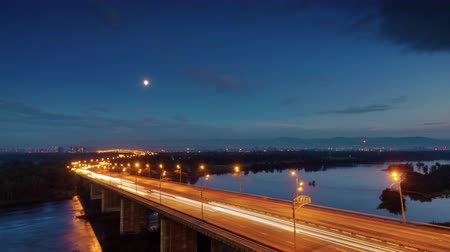 sunset city : sunset night light krasnoyarsk city traffic bridge road 4k time lapse russia