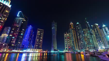 cayan tower : dubai marina night illumination yacht dock panorama 4k time laps euae