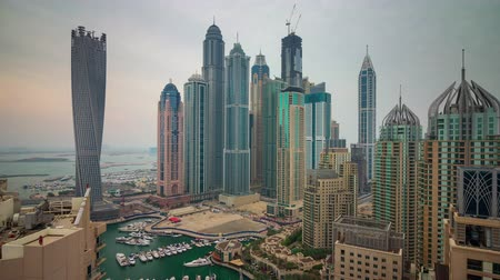 cayan tower : dubai marina famous buildings yacht dock roof panorama 4k time lapse uae