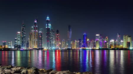 cayan tower : night light illumination dubai marina palm bay panorama 4k time lapse uae