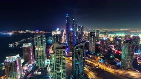 cayan tower : dubai marina downtown night roof top panorama 4k time lapse uae Stock Footage