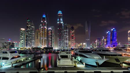 cayan tower : night dubai marina palm private yacht dock panorama 4k time lapse uae