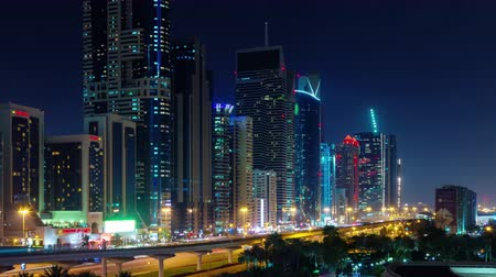 cayan tower : dubai night illumination downtown traffic street panorama 4k time lapse uae