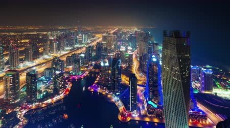 cayan tower : dubai marina night illumination roof top panorama 4k time lapse uae