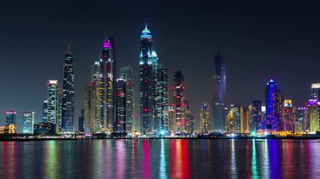 cayan tower : dubai marina night light illumination palm bay panorama 4k time lapse uae