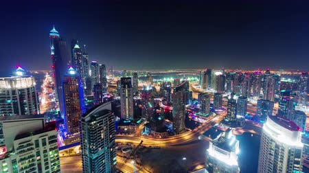 cayan tower : dubai marina night illumination traffic roof top panorama 4k time lapse uae
