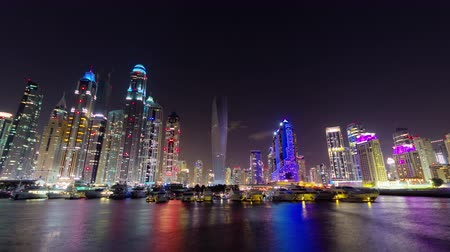 cayan tower : night illumination dubai marina palm panorama 4k time lapse uae Stock Footage