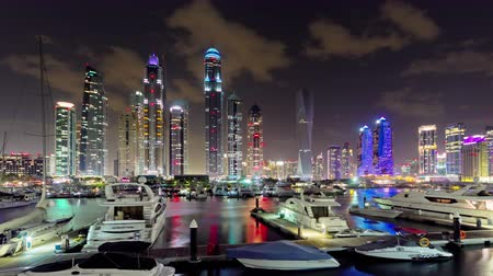 эмираты : sunset night dubai marina yacht dock beach panorama 4k time lapse uae Стоковые видеозаписи