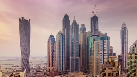 cayan tower : dubai marina day light traffic road  city street 4k time lapse uae
