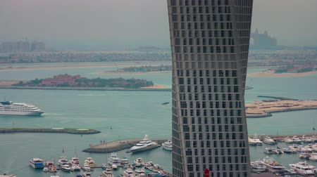 cayan tower : dubai marina famous tower palm hotel bay view 4k time lapse uae
