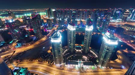 cayan tower : night illumination dubai marina traffic streets roof panorama 4k time lapse uae