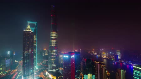 night shanghai city downtown buildings roof top panorama 4k time lapse china