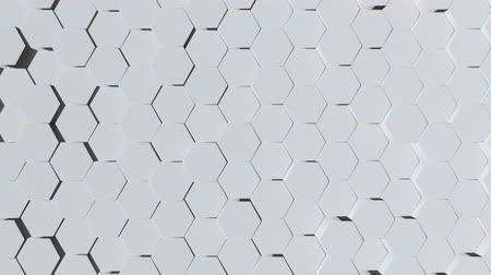 Loop of white animated honeycomb technology with hexagons that pop in and out