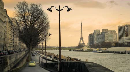 View of the Eiffel Tower from the roadside of the Seine River Стоковые видеозаписи