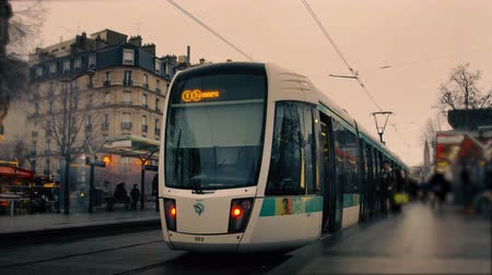 Time lapse of a Tramway line station in Paris France with crowds of busy stressed people commuting and moving fast, and two tram trains stopping on the railroads under a pink cloudy sky