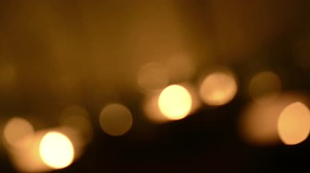 religioso : Rotating background blur of candles burning with defocused bokeh effect