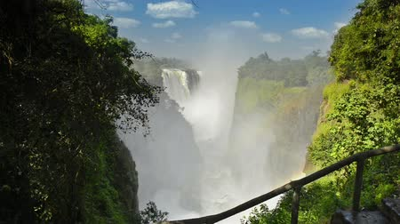 zambia : Victoria Falls Devils Cataract or Mosi-oa-Tunya waterfall in southern Africa on the Zambezi River at the border of Zambia and Zimbabwe in high definition footage. Victoria Falls is one of the 7 Wonders of the Natural World.