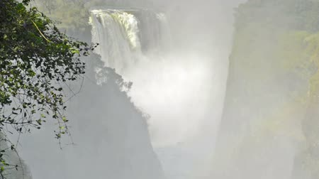 zambia : Victoria Falls Devils Cataract or Mosi-oa-Tunya waterfall in southern Africa on the Zambezi River at the border of Zambia and Zimbabwe in high definition footage with slow zoom out. Victoria Falls is one of the 7 Wonders of the Natural World. Stock Footage